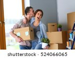 happy young couple unpacking or ... | Shutterstock . vector #524066065