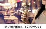 woman holding microphone in... | Shutterstock . vector #524099791