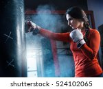 young woman training punch... | Shutterstock . vector #524102065