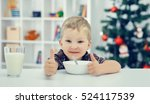 Small Boy Eating And Showing A...