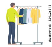 man near rack with clothes.... | Shutterstock .eps vector #524126545