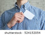 man holding white business card ...   Shutterstock . vector #524152054