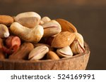 mix of nuts on a wooden table | Shutterstock . vector #524169991
