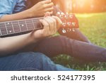 Small photo of Man's hand holding guitar chords, train all the time.