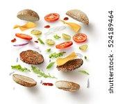 burger with flying ingredients | Shutterstock . vector #524189464