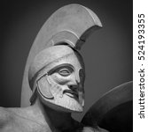 Small photo of Head in helmet Greek ancient sculpture of warrior.