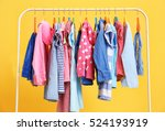 clothes hanging on rack  closeup | Shutterstock . vector #524193919