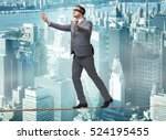 man walking in tight rope... | Shutterstock . vector #524195455