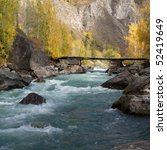 Scenic View Of Cold River And...