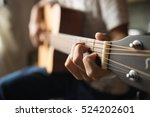 to play the guitar. | Shutterstock . vector #524202601
