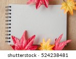 Notebook And Maple Leaves In...