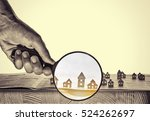 hand holds the magnifying glass ... | Shutterstock . vector #524262697