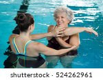 young trainer helping senior... | Shutterstock . vector #524262961