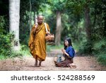asian woman giving alms to... | Shutterstock . vector #524288569