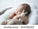 sweet newborn baby sleeps with... | Shutterstock . vector #524300305