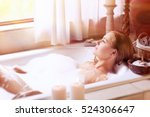 beautiful woman lying down in... | Shutterstock . vector #524306647