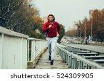 man in red hoodie jogging... | Shutterstock . vector #524309905