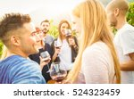 happy friends drinking wine and ... | Shutterstock . vector #524323459