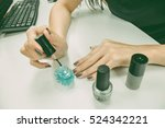 woman applying nail polish on... | Shutterstock . vector #524342221