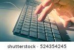 man's hand on computer keyboard | Shutterstock . vector #524354245