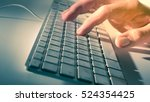 man's hand on computer keyboard | Shutterstock . vector #524354425