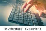 man's hand on computer keyboard | Shutterstock . vector #524354545