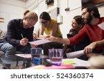 designers sitting on sofa... | Shutterstock . vector #524360374
