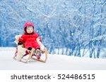 little boy enjoying a sleigh... | Shutterstock . vector #524486515