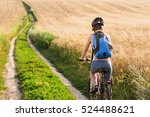 Happy Young Woman Riding...