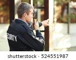 male security guard near... | Shutterstock . vector #524551987