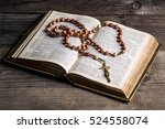 Rosary With Cross On Old Open...
