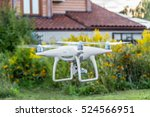 Small photo of RC quadrocopter with a video camera is flying at a low altitude above the ground