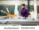women worker using saw machine... | Shutterstock . vector #524567401