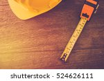 safety helmet and measure tape... | Shutterstock . vector #524626111
