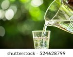 glass of water on nature... | Shutterstock . vector #524628799