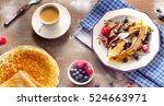 crepes with berries  chocolate... | Shutterstock . vector #524663971