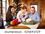 young family lighting candles... | Shutterstock . vector #524691529