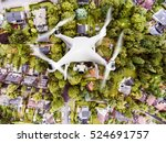 hovering drone taking pictures... | Shutterstock . vector #524691757