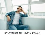 young man is sitting on sofa... | Shutterstock . vector #524719114
