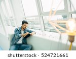 writing man is sitting on sofa... | Shutterstock . vector #524721661