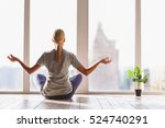 healthy girl meditating with... | Shutterstock . vector #524740291