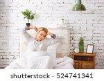 Smiling Girl Awakes In Bedroom