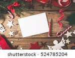 Empty Christmas Card On Wooden...