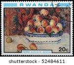 Small photo of RWANDA - CIRCA 1984: A stamp printed in Rwanda shows draw by artist Pierre Auguste Renoir - Peaches and Pears, circa 1984