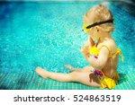 baby sitting near swimming pool. | Shutterstock . vector #524863519