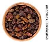 raisins in wooden bowl made of... | Shutterstock . vector #524870485