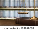 Scales Of Justice On Law Books...