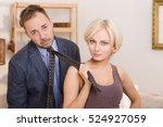 blond lady keeping her husband... | Shutterstock . vector #524927059