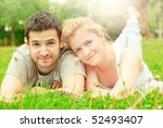 young teenage couple lying on a ... | Shutterstock . vector #52493407