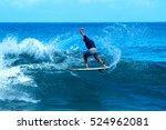 surfer doing tricks in large... | Shutterstock . vector #524962081